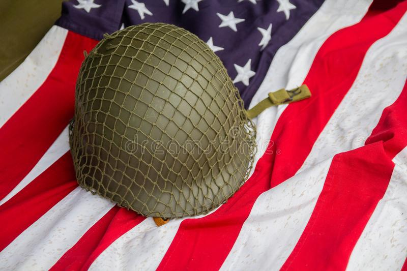 Soldier`s helmet and the times of the Second World War and the US flag. Patriotism stock images