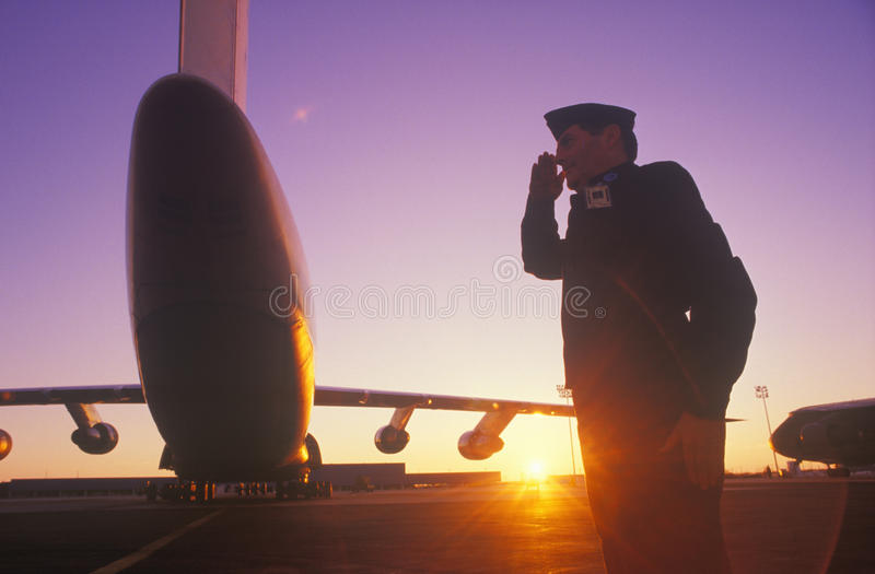 Soldier Saluting. By Cargo Plane, Dover Airforce Base, Dover, Delaware stock photo