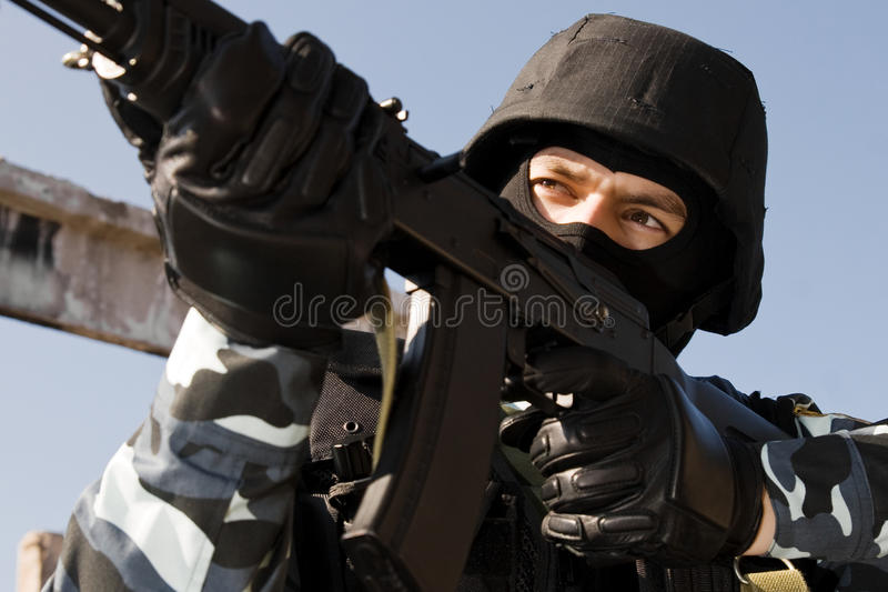 Soldier shooting with a gun stock image