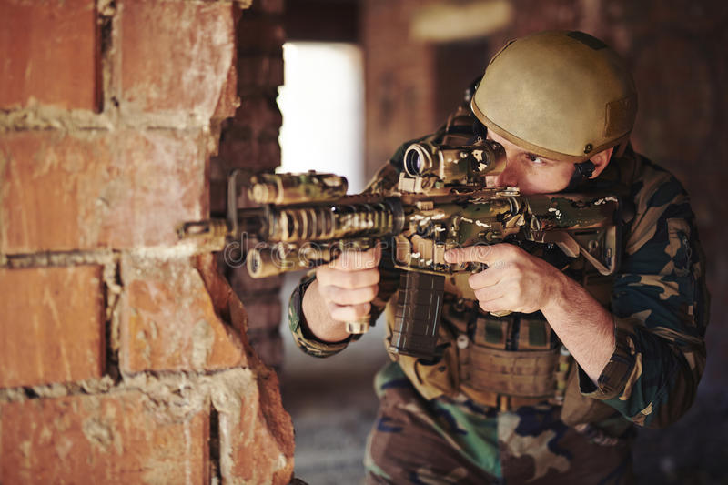 Soldier shooting royalty free stock photography