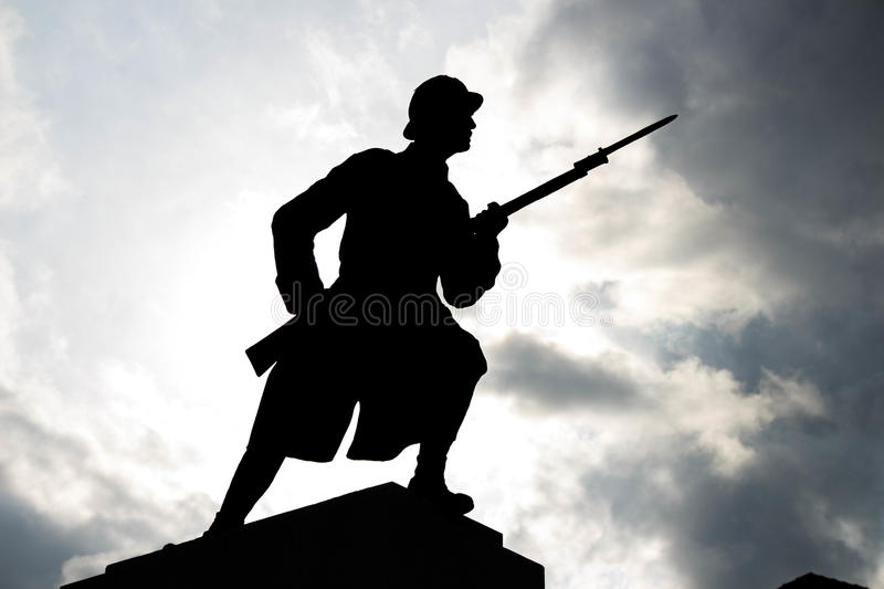 Soldier Silhouette under cloudy sky. World War II Soldier Silhouette under cloudy sky stock photography