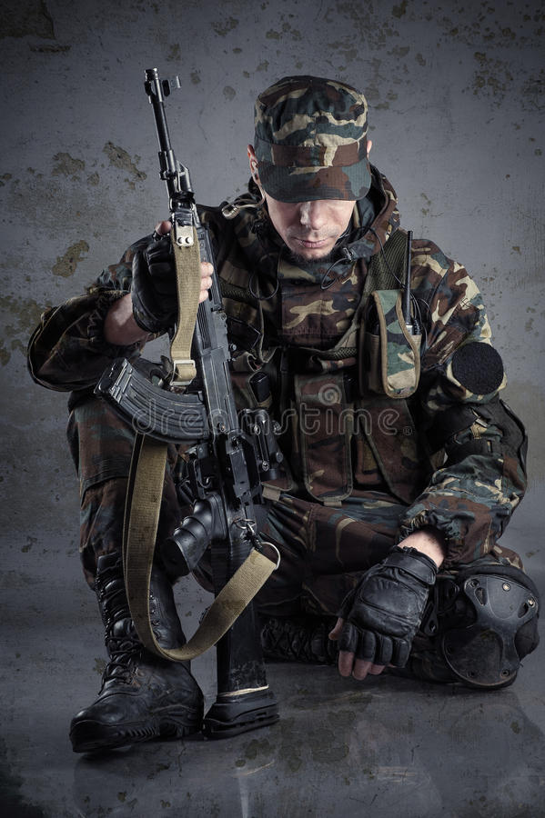 Soldier sitting on the floor stock images