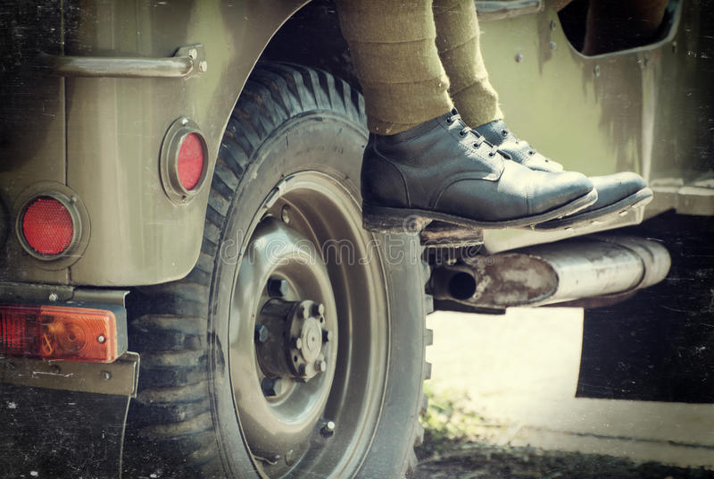 Soldier sitting on the jeep. Military theme royalty free stock photography