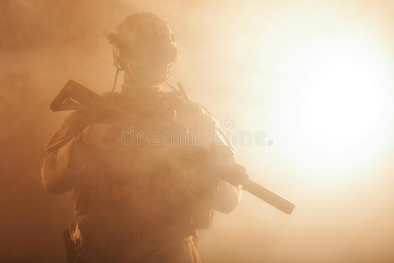Soldier in the smoke stock photography