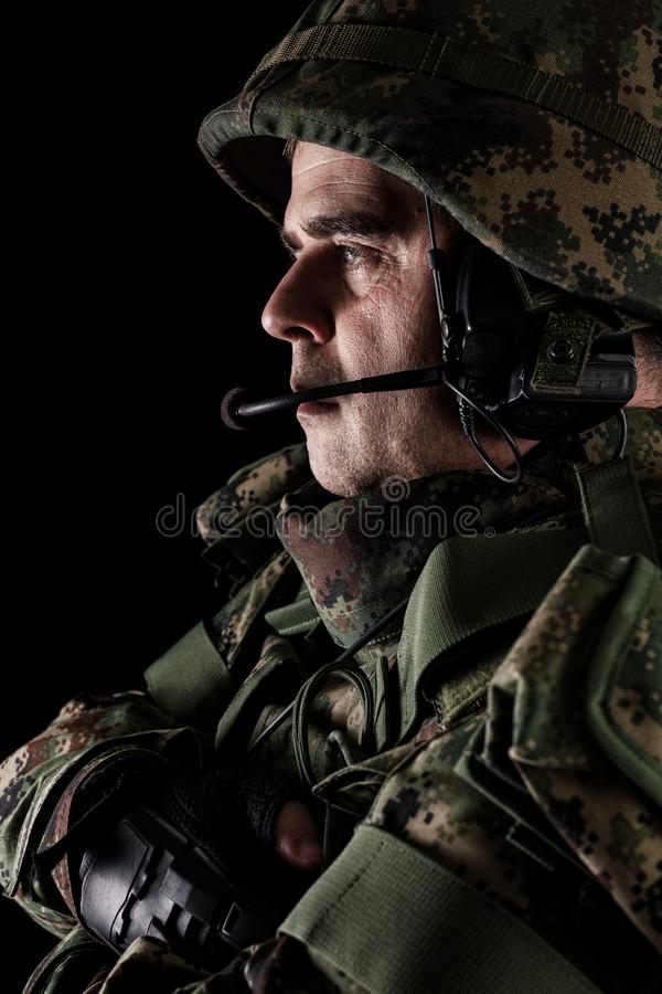 Soldier special forces with rifle on dark background. Young Soldier special forces with rifle on dark background royalty free stock images