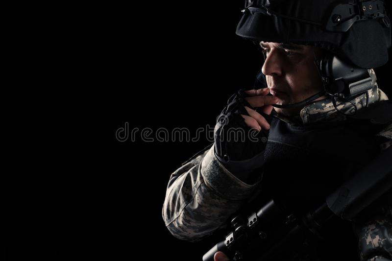Soldier special forces with rifle on dark background. Young Soldier special forces with rifle on dark background stock photography