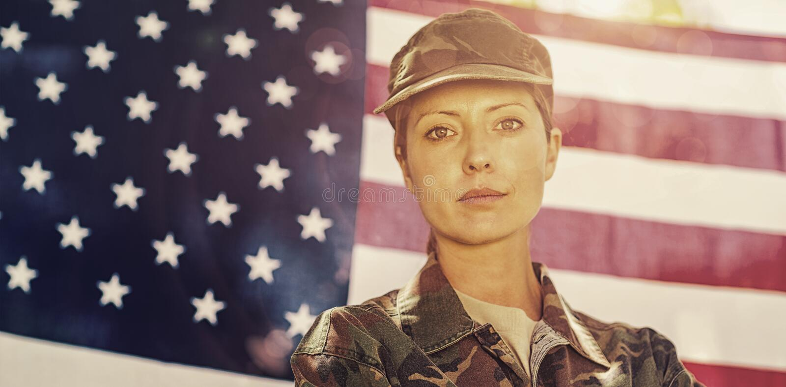 Soldier standing in front of american flag. Portrait of soldier standing in front of american flag stock images