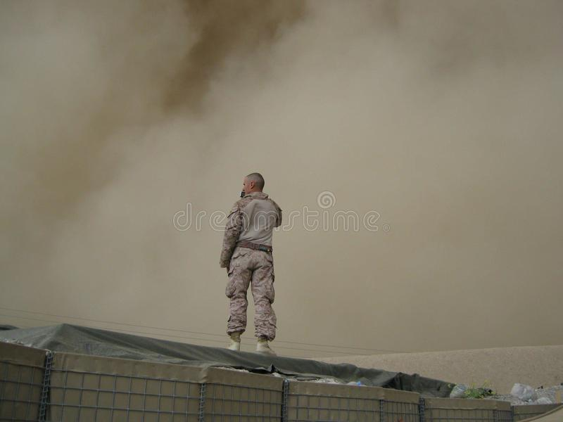 Soldier Standing On Top Of A Black Tarp Covered Equipments Free Public Domain Cc0 Image