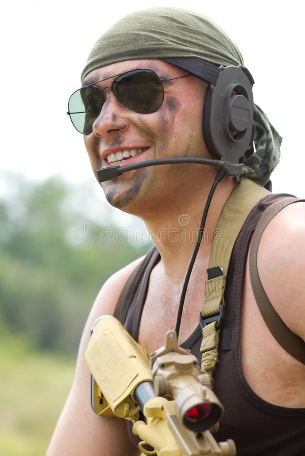 Soldier in sunglasses smiling royalty free stock image