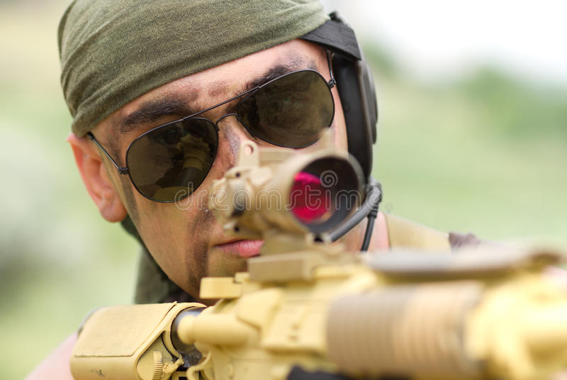Soldier in sunglasses targeting royalty free stock photos