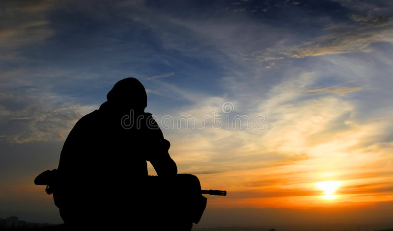 Soldier at sunset stock photo