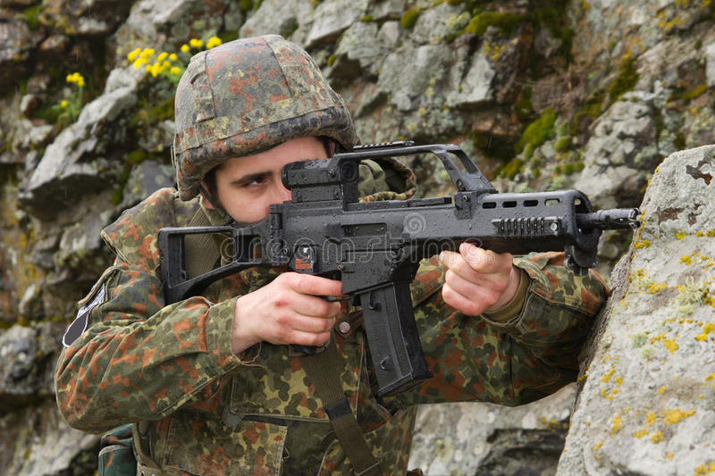 Soldier targeting with automatic rifle stock photos