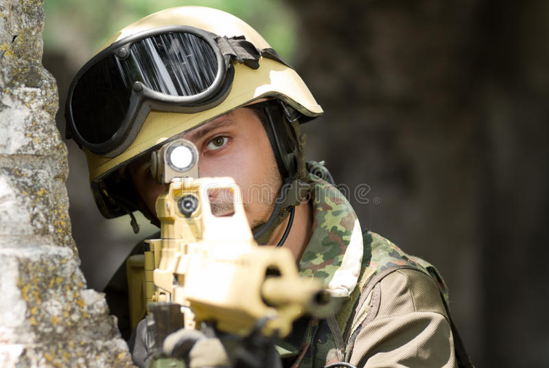Soldier targeting with a rifle royalty free stock photography