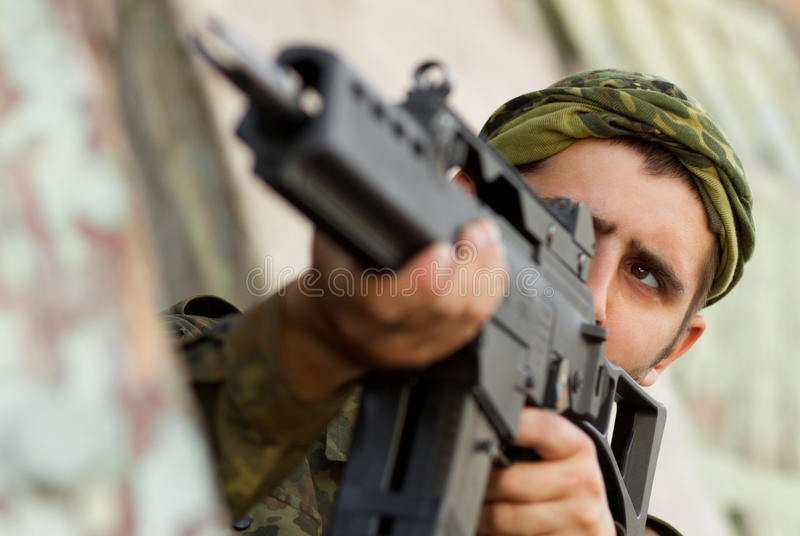 Soldier targeting with a rifle stock image