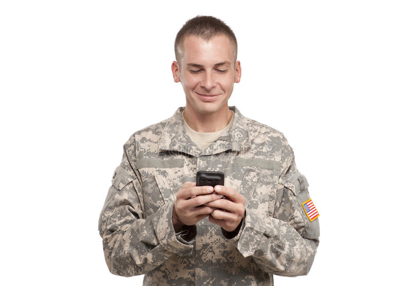 Military Man Texting stock image