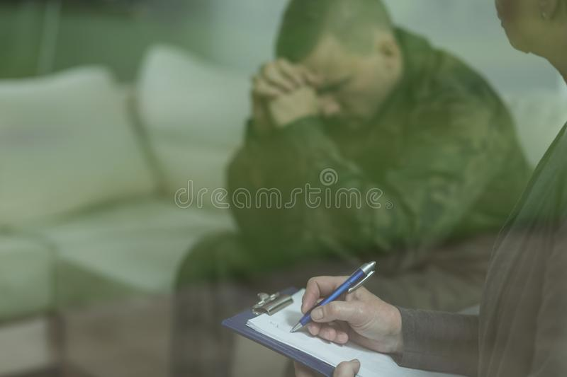 Soldier during therapy of depression royalty free stock photography