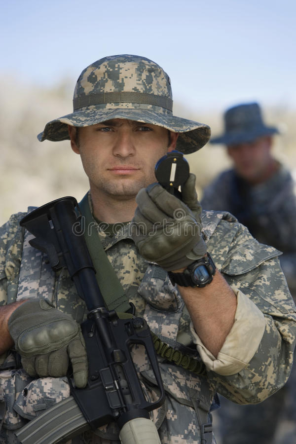 Soldier Using Compass stock images