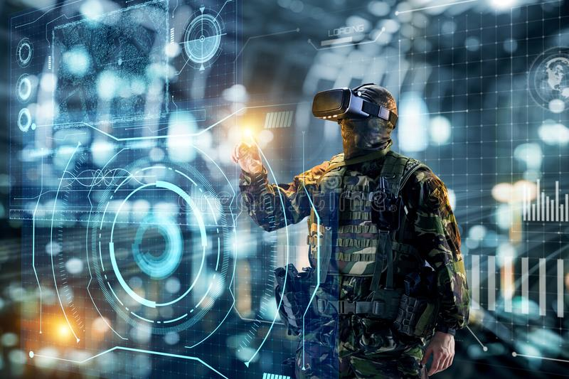 Soldier in virtual reality glasses. Military concept of the future. stock photos