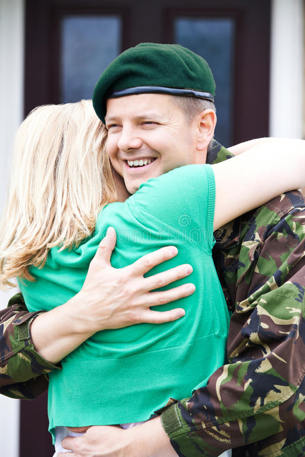 Soldier Visiting Home On Leave Hugging Wife royalty free stock image