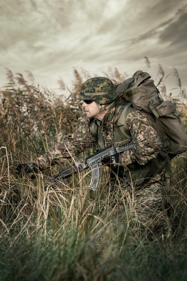 Soldier at war in the swamp. Young soldier at war in the swamp stock photography