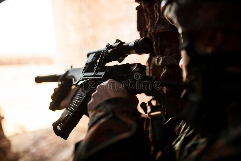 Soldier in the war to aim with weapons royalty free stock photo