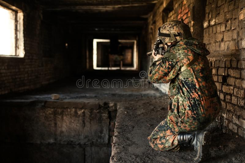 Soldier in the war to aim with weapons stock photos