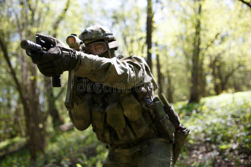 Soldier with weapons in intelligence royalty free stock photo