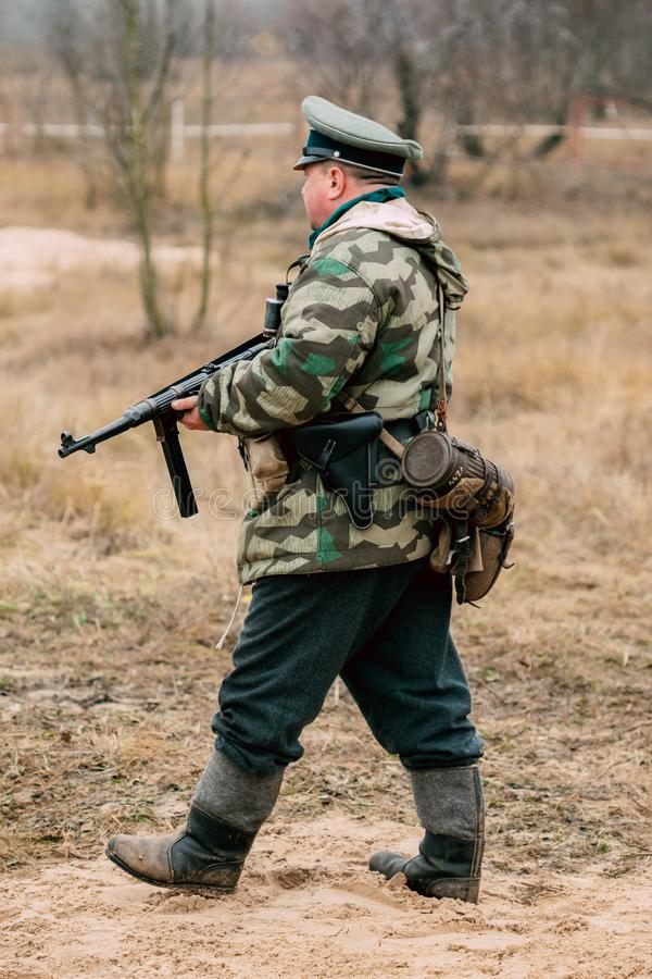 Soldier of the Wehrmacht with a gun in his hands. Gomel, Belarus - November 26, 2017: German soldier Wehrmacht infantryman with a submachine gun in his hands stock photography