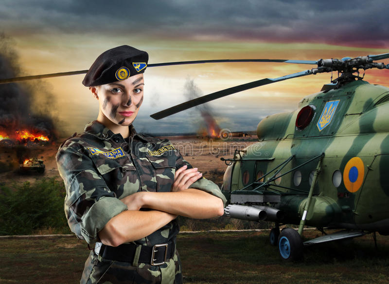 Soldier woman in military uniform stock image