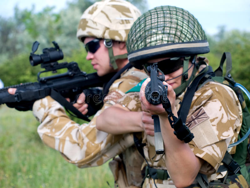 Download Soldiers in action stock image. Image of desert, firearms - 10104587