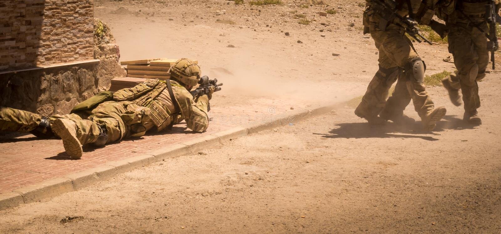 Soldiers in action in conflict zone III stock images