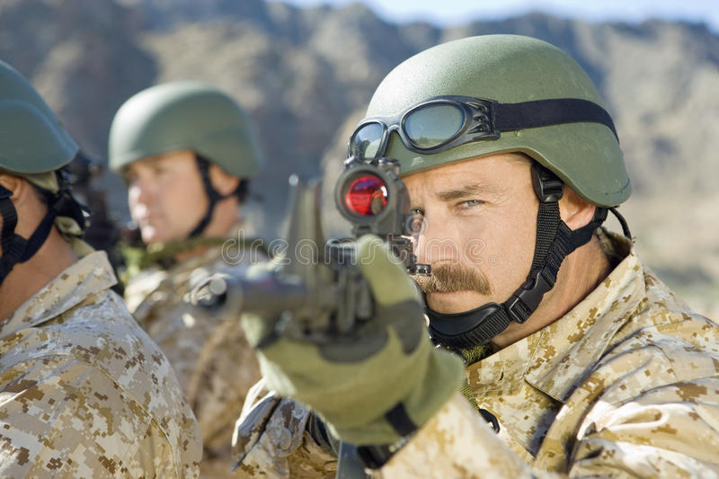 Download Soldiers Aiming Rifles stock photo. Image of mission - 29655840