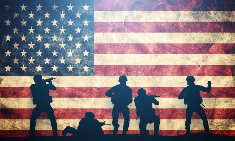 Soldiers in assault on USA flag. American army, military. Soldiers in assault on grunge USA flag. American army, military concept