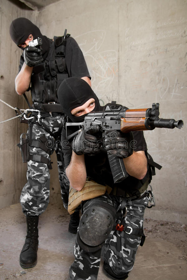 Soldiers in black masks with weapons royalty free stock images
