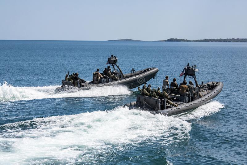 Two motor boats with two teams of sea soldiers are moving at a fast speed into the sea.Editorial use only. Black Sea/Bulgaria/04.2 royalty free stock images