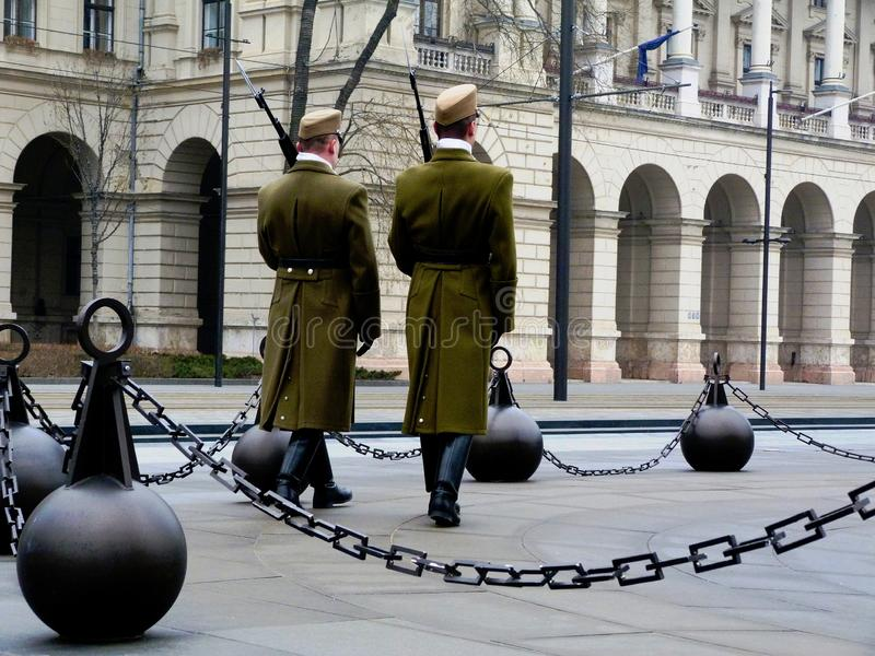 Soldiers at the Budapest Parliament in green winter uniform performing guard service. In formation with rifles on the shoulder and bayonets attached in old stock image