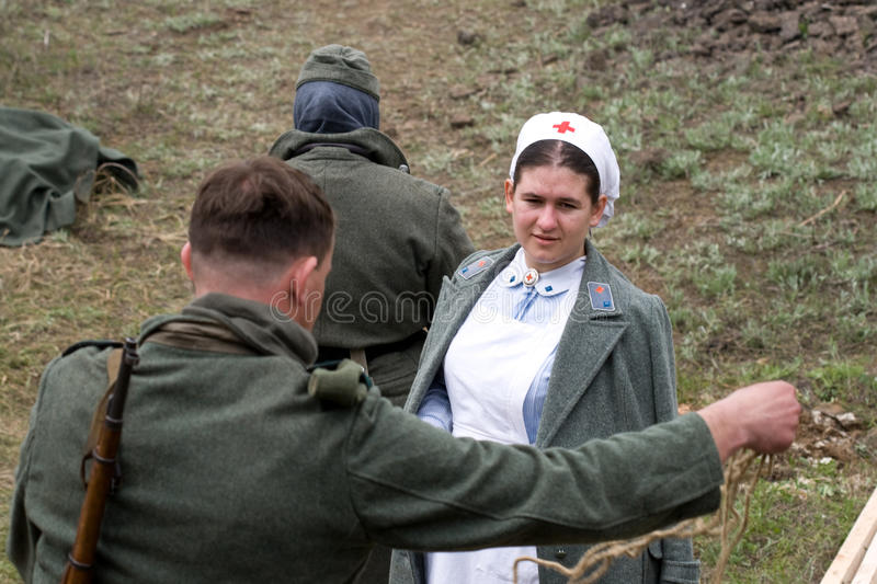 Download Soldiers Came To The Nurse Editorial Stock Image - Image: 13893154