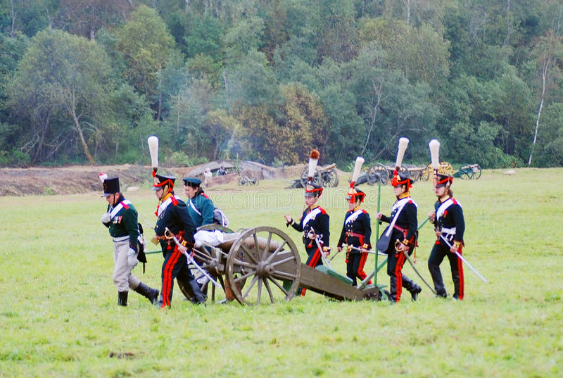 Soldiers carry a cannon royalty free stock images