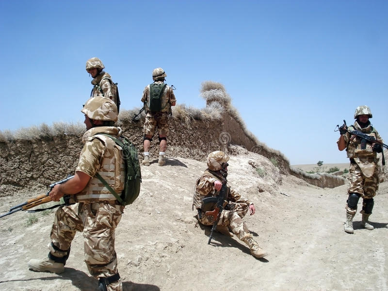 Soldiers clearing the area stock image