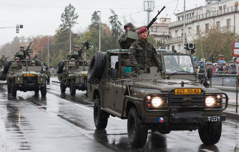 Soldiers of Czech Army are riding Land Rover Defender cars on military parade. European street, Prague-October 28, 2018: Soldiers of Czech Army are riding Land stock photo