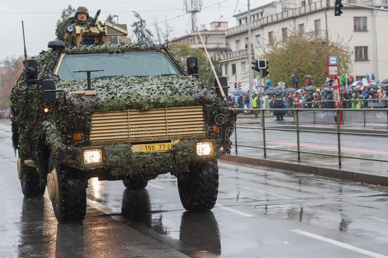 Soldiers of Czech Army are riding Light Armored Vehicle Dingo 2 on military parade stock images