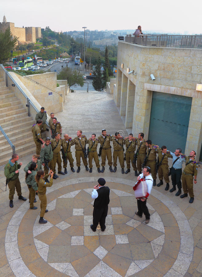 The soldiers are dancing. JERUSALEM - DEZEMBER 10 - IDF soldiers are dancing near the walls of ancient Jerusalem. 10 Dezember 2010 in Jerusalem, Israel royalty free stock image