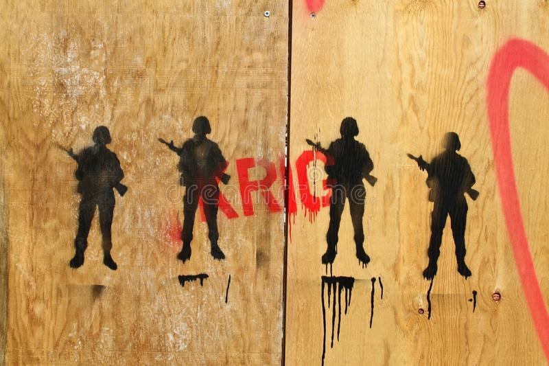 Soldiers drawed on some wood royalty free stock photo