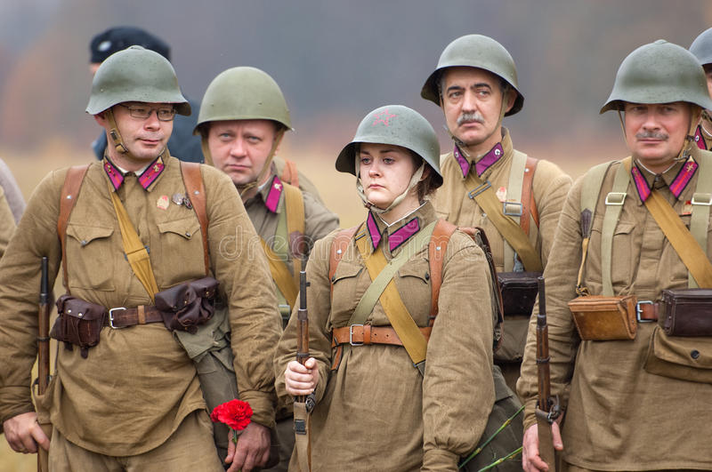 Soldiers with flowers stock image