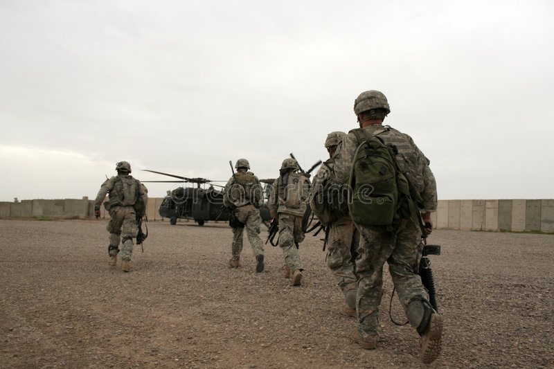 Soldiers in Helicopter in Iraq stock images