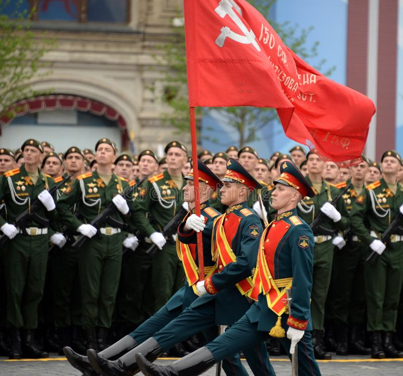 Soldiers of the honor guard of a separate commandant regiment of the Transfiguration bear the banner of Victory. MOSCOW, RUSSIA - MAY 9, 2019: Soldiers of the royalty free stock photos