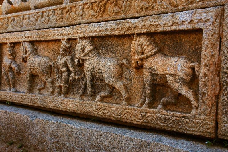 Soldiers with horses sculpture at the Vittala Temple, Hampi, Karnataka, India.  royalty free stock photos