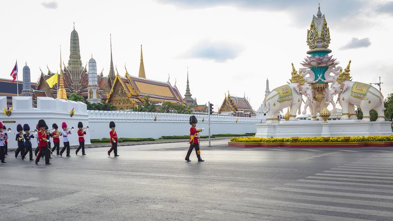 Soldiers march across the Grand Palace in Bangkok. stock image