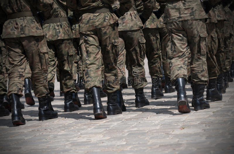Soldiers march in formation royalty free stock image