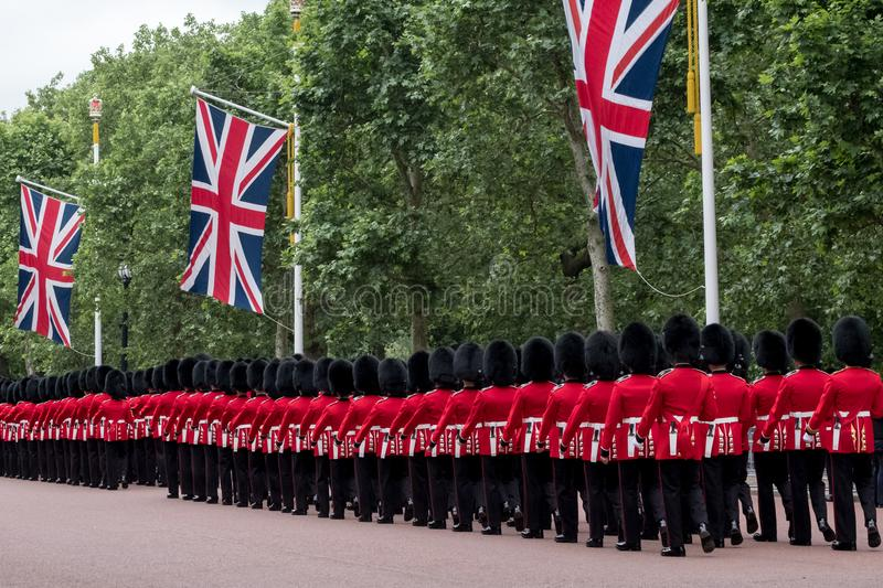 Soldiers marching down The Mall in London during the Trooping the Colour military ceremony, London. London UK. Soldiers with rifles and bayonets marching down royalty free stock photography